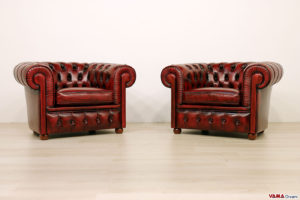 Poltrone rosse trapuntate capitonnè Chesterfield