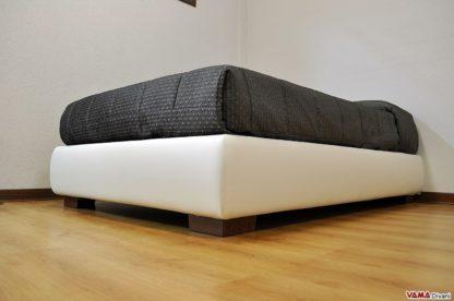 piedino per letto in legno