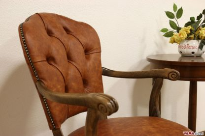 poltrona sedia girevole classica imbottita capitonnè