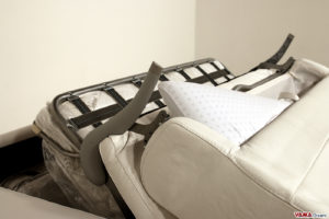 Divano letto in pelle con porta cuscini